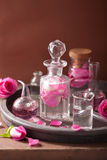 Alchemy aromatherapy with rose flowers flasks Royalty Free Stock Photography