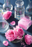 Alchemy and aromatherapy set with rose flowers and chemical flas Stock Images