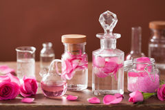 Alchemy and aromatherapy set with rose flowers and flasks.  Stock Photography