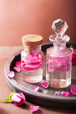 Alchemy and aromatherapy set with rose flowers and flasks Royalty Free Stock Photo