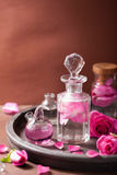 Alchemy and aromatherapy set with rose flowers and flasks Stock Images