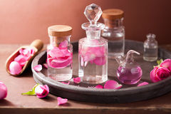 Alchemy and aromatherapy set with rose flowers and flasks Royalty Free Stock Image