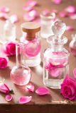 Alchemy and aromatherapy set with rose flowers and flasks Royalty Free Stock Images