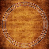 Alchemy background. Circle with astrological and alchemy symbols over medieval text Royalty Free Stock Photos
