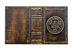 Alchemy book with gilded transmutation circle in center of the front cover, attributed to a German alchemist from the 17th century. Alchemy leather book with stock photos