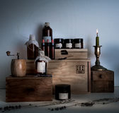 Alchemy lab. bottles, jars, candle on wooden shelves Stock Images