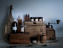 Alchemy lab. bottles, jars, dried wormwood bouquet on wooden shelves Royalty Free Stock Image