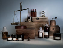 Alchemy lab. bottles, jars, scales, clock on wooden shelves Royalty Free Stock Image