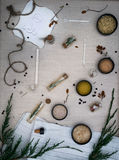 Alchemy Lab. dried herbs, salt, flasks, recipes on the old canvas. top view. Alchemy Lab. dried herbs, salt, flasks, recipes on the old canvas Royalty Free Stock Photo