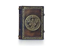 Alchemy leather book with gilded transmutation circle attributed to a German alchemist from the 17th century. The book is captured frontal, isolated while royalty free stock photo
