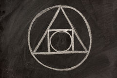 Alchemy symbol on a blackboard Stock Images