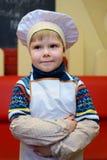 Alchevsk Ukraina, Styczeń, - 21, 2018: dziecko w formie szefa kuchni pozować Fotografia Royalty Free