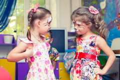 Alchevsk, Ukraine - August 3, 2017: A child draws a face for a children`s party. Aqua makeup for girls and boys. Children`s party royalty free stock images
