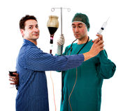 Alchol problem with bizarre doctor Stock Image
