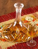 Alcholic decantor. A Decanter for alcoholic beverages filled with brandy Royalty Free Stock Photo
