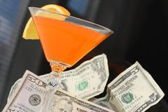 Alcholic Fruit Cocktail and Money Royalty Free Stock Photography