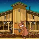 Alci sorridenti del personaggio dei cartoni animati che stanno vicino al granaio di legno Fotografia Stock