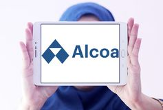 Alcoa Corporation logo. Logo of Alcoa Corporation on samsung tablet holded by arab muslim woman. Alcoa is an American industrial corporation. It is the world`s Royalty Free Stock Image