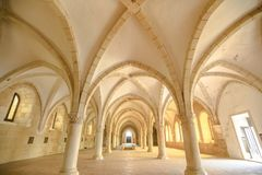 Alcobaca Monastery Dormitory. Alcobaca, Portugal - August 15, 2017: The dormitory, a big gothic room where the monks slept together, inside Monastery of Alcobaca royalty free stock images