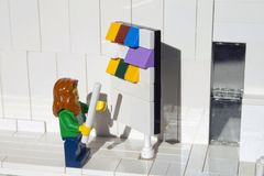 Alcobendas, Spain - February 24, 2019. Woman checking to scrum kanban task board in office, Lego minifigures are manufactured by stock images