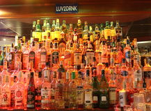 Alcohol. Different variate of alcohol drinks in a bar with sign Love 2 drink Stock Photo