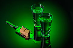 Alcohol Absinthe with a sugar cubes and spoon on black Royalty Free Stock Photography