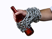 Alcohol abuse. Hand man, chained to a bottle of wine Royalty Free Stock Photography