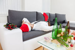 Alcohol abuse during holiday period. Can hurt Stock Photography