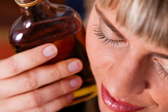 Alcohol abuse - woman drinking too much brandy Royalty Free Stock Photo