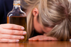 Alcohol abuse - woman drinking too much brandy Royalty Free Stock Images