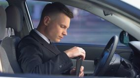 Alcohol addicted male drinking on driver seat, starting engine, accident hazard. Stock footage stock video footage