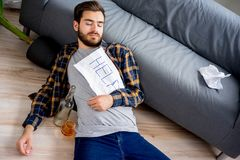 Alcohol addicted man. Is holding a help sign stock photo