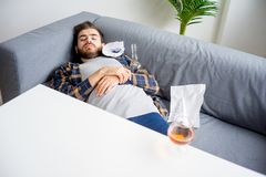 Alcohol addicted man. Is sleeping at home stock images