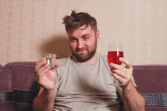 Alcohol addicted man choose drink for hangover Stock Photos