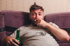 Alcohol addicted man in depression. Stock Images