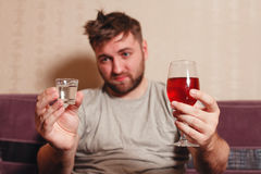 Alcohol addicted man after hard drinking. Royalty Free Stock Images
