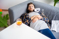 Alcohol addicted man. Is sleeping at home stock photo