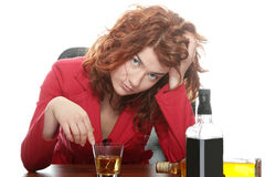 Alcohol addiction. Alone young woman in depression, drinking alcohol (burbon Royalty Free Stock Photos