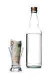 Alcohol addiction. Money lost through alcohol addiction Royalty Free Stock Image
