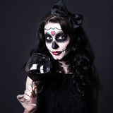 Alcohol addiction concept - woman with Halloween skull make up h Royalty Free Stock Image
