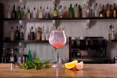 Alcohol bar, cocktail glass on bar counter, cocktail glass in a bar, royalty free stock image