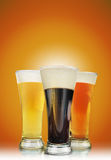 Alcohol Beer Glasses with Foam Royalty Free Stock Image