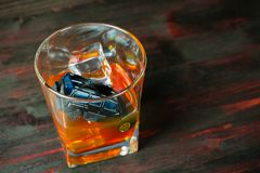 Alcohol behind the wheel. Harmful and dangerous. Stock Photos