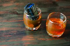 Alcohol behind the wheel. Harmful and dangerous. Royalty Free Stock Photography