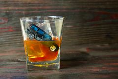 Alcohol behind the wheel. Harmful and dangerous. Royalty Free Stock Photo