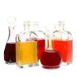 Alcohol bottle. Glasses with color liqueur Royalty Free Stock Image