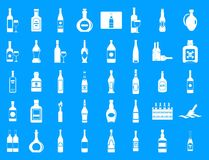 Alcohol bottle icon blue set vector. Alcohol bottle icon set. Simple set of alcohol bottle vector icons for web design isolated on blue background Stock Photos