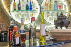 Alcohol bottles set in counter at bar Royalty Free Stock Image