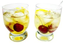 Alcohol brandy cocktail with cherry Stock Photos