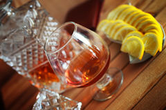 Alcohol brandy set glass and carafe Stock Images